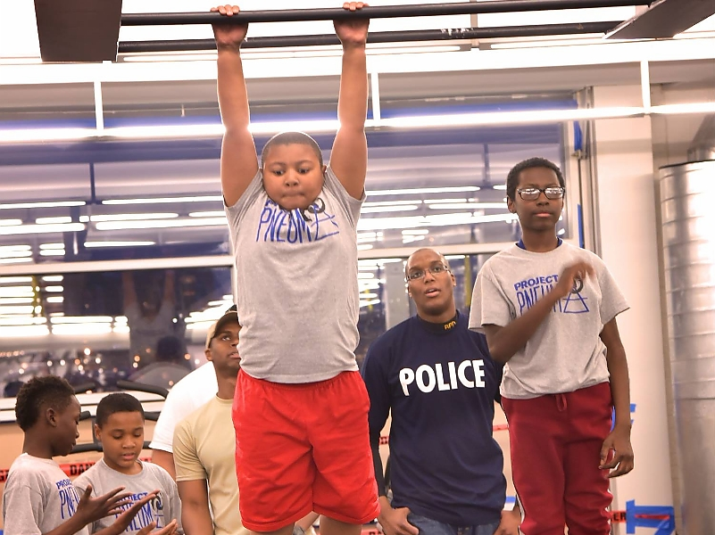 Project Pneuma boys training with Police